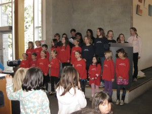 The choir singing in the Whistler Public Library